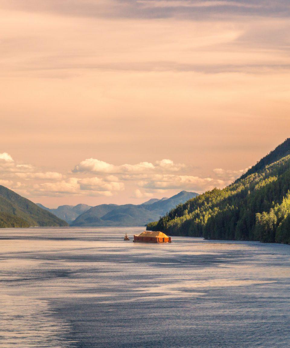 Pacific coast tugboat pulling barge, Principe Channel, British Columbia, Canada.