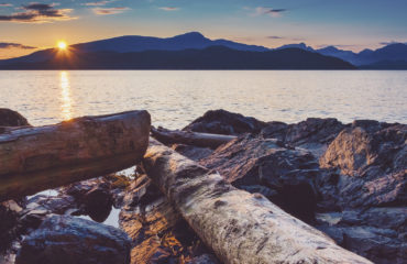 Sailing and rocky sunset beaches in the pacific north west with