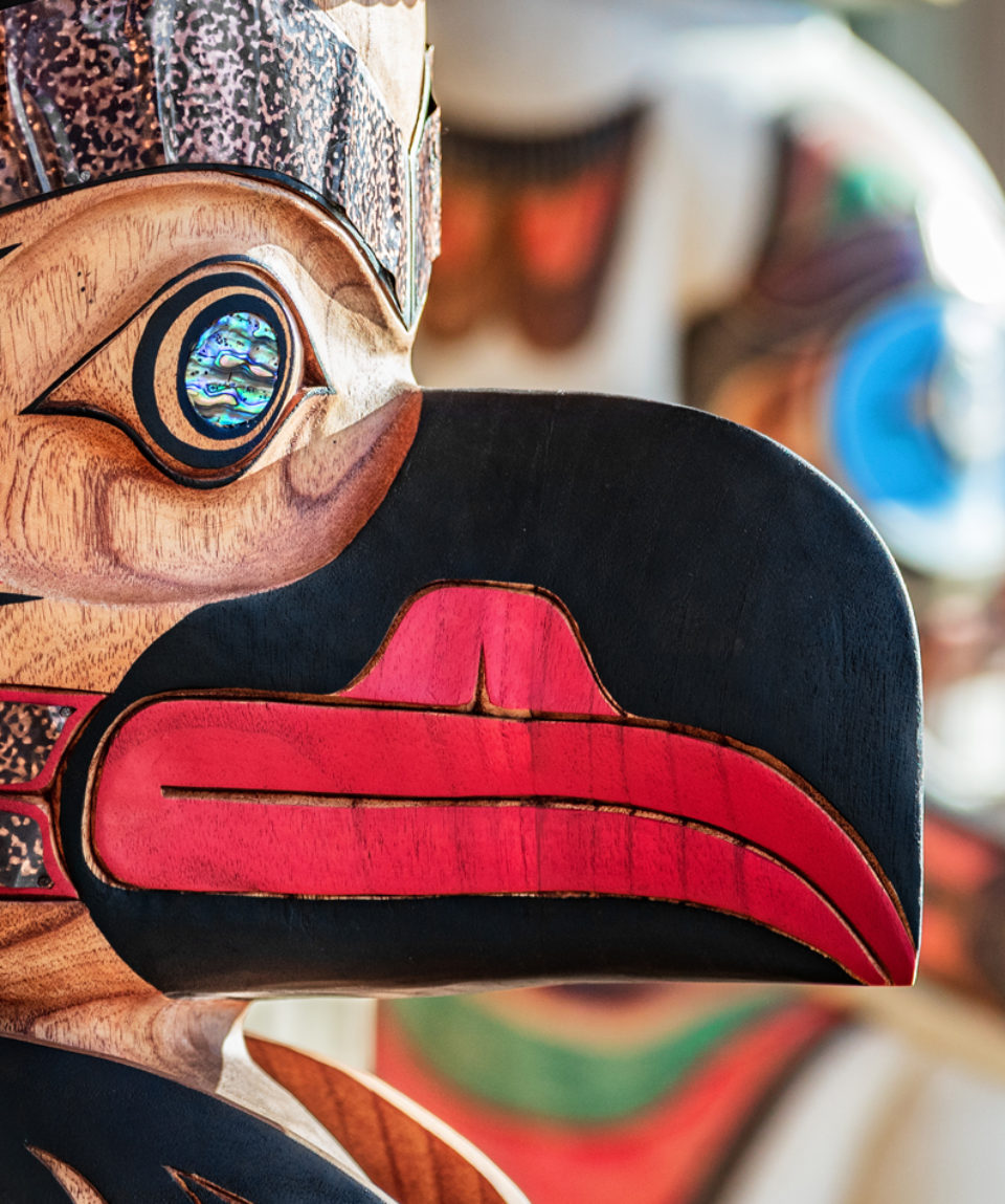 Alaska totem pole carving art sculture store in tourist travel attraction town on Alaska cruise. Ketchikan, Juneau, Skagway stores and shops selling native paintings and art.