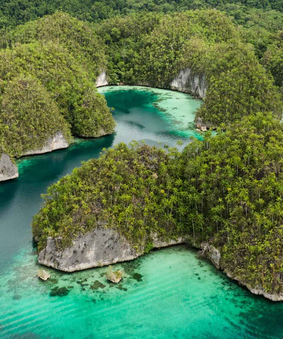 Aerial View Of Triton Bay In Raja Ampat Islands: Lagoon With Tur